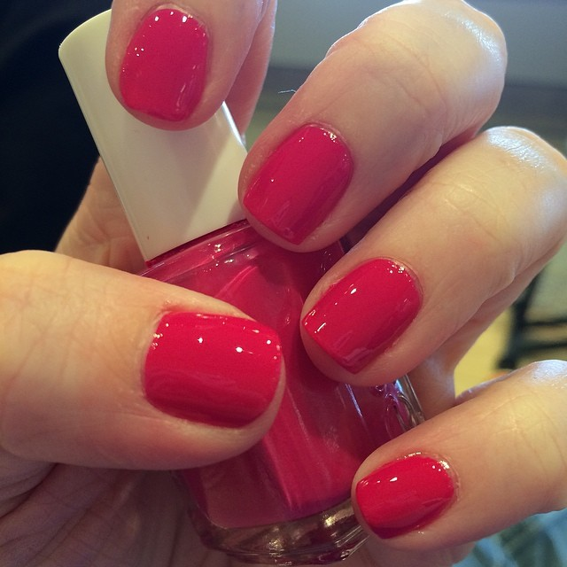 Not too bad for an airport manicure. ;) Color is Bachelorette Bash from Essie.