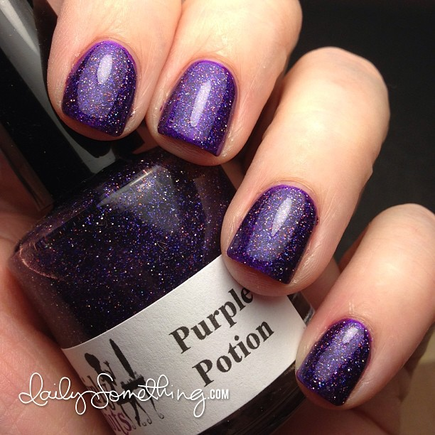 Can't resist a good purple glitter polish. This one is Purple Potion from Girly Bits.