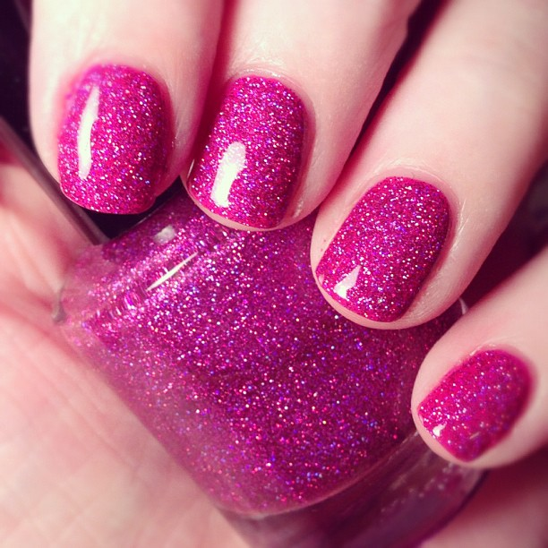 HOLY CRAP! This polish is amazing! Indoor lighting doesn't do it justice. Girly Bits Razzle Dazzle.
