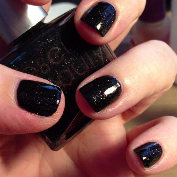 Loving this black glitter polish. Polish is Fashion Polish from Rescue Beauty Lounge.