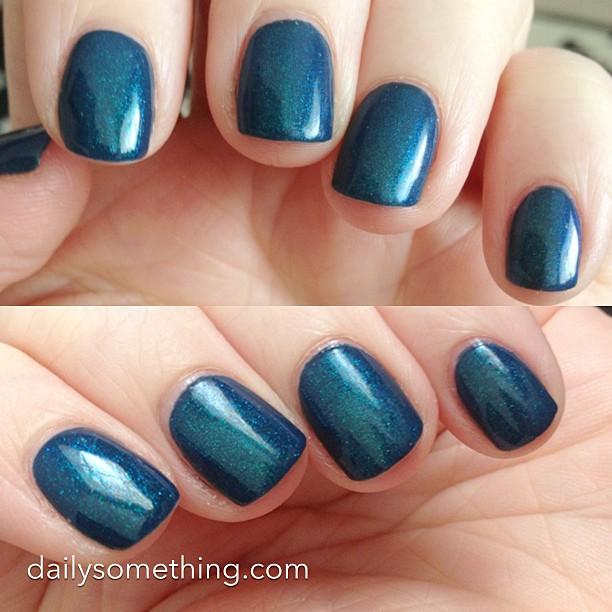 Today's manicure: two coats of Julep Eloise (navy), with one coat Girly Bits Cosmic Ocean. :)