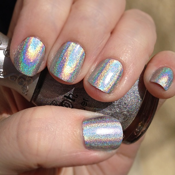 Yay! My first holo polish arrived 2day. It's totally intense! Might stamp over it. Nfu Oh 61.